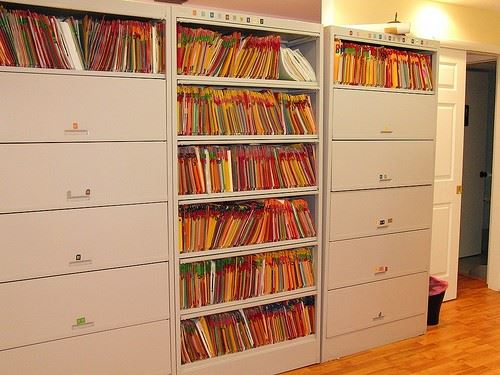 Several filled filing cabinets